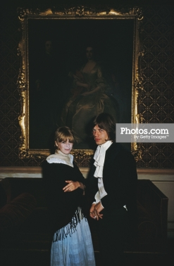 August 1968: Singer Marianne Faithfull and Mick Jagger of the Rolling Stones stand in front of a gilt framed portrait in Castletown Mansion, Eire. (Photo by Slim Aarons/Getty Images)